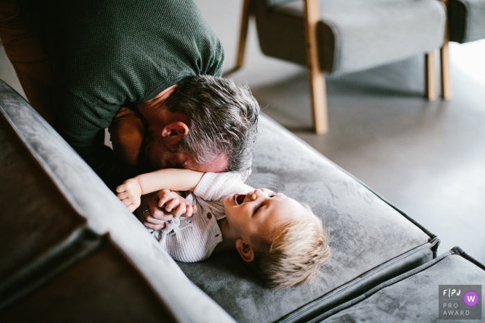 NL fun family/child image shoot in the home of a moment between dad and son
