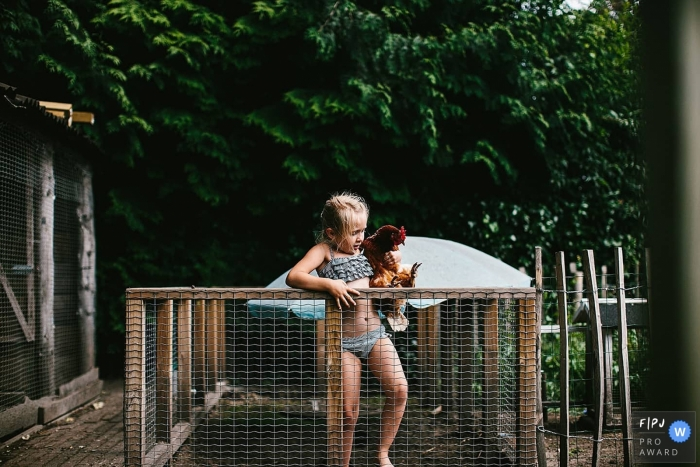 NL family photography in the backyard with chickens during the pandemic in the summer of 2020