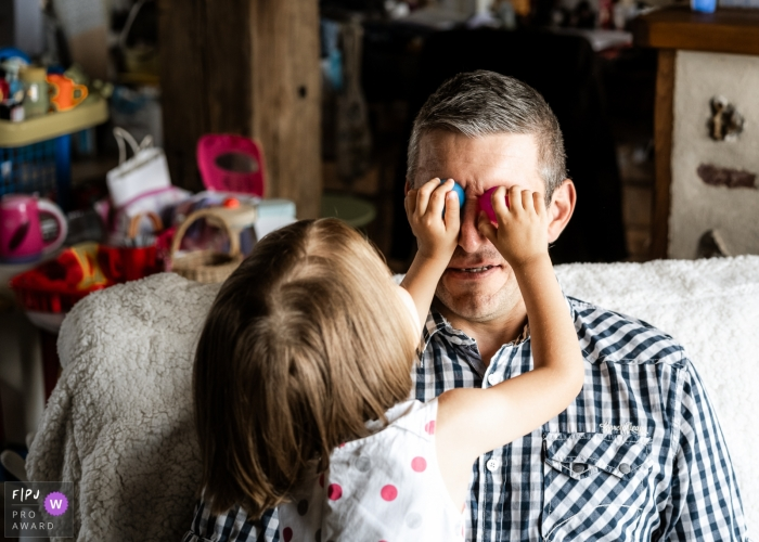 France color family image shoot in the home with a Little girl playing with her dad in CLV