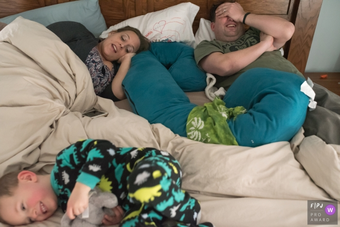 Connecticut Family Photographer captures this family in bed taking a nap
