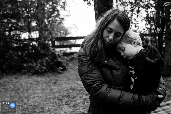 Mom and child hug each other in this Seattle Family photo