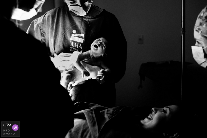 Maternidade Ilha hospital documentary birth photography showing the newborns arrival in BW