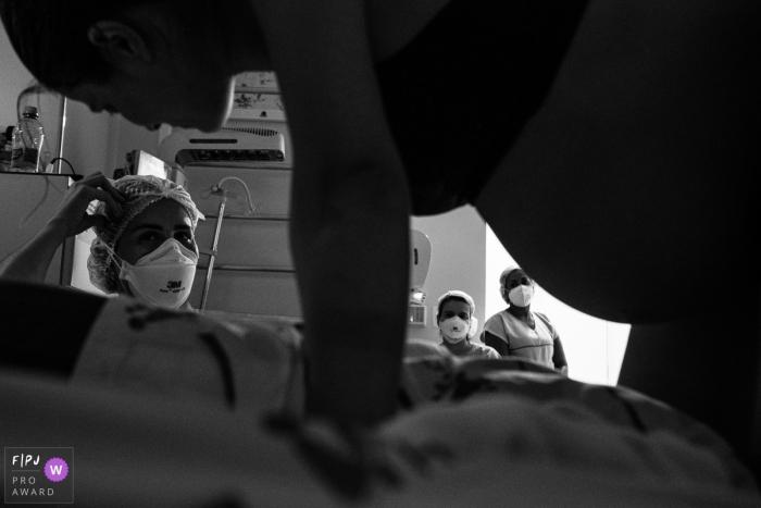 Sao Paulo hospital documentary birth photography showing the team work involved