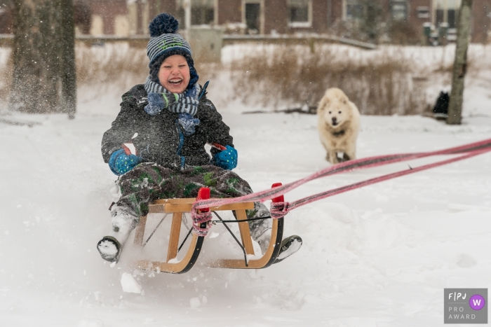 Flevoland at home Day in the Life photography with a kid and dog Having fun in the snow
