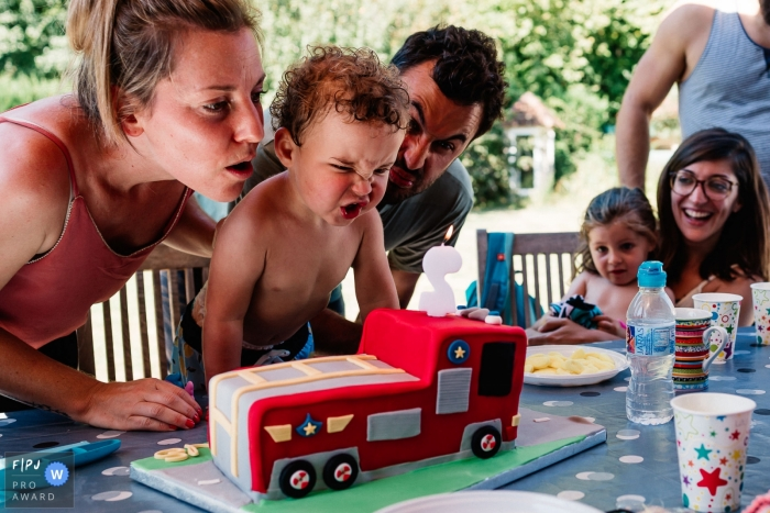 France Day in the Life Session of documentary family photography showing a Little boy birthday party with his parents