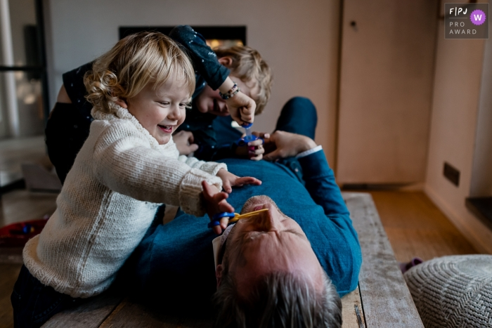 Day in the Life photography session at home inWallonie with the kids playing doctor using dad as a patient