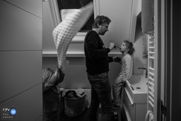 Netherlands at home Day in the Life photography in BW showing the Getting ready for bed and brushing teeth in the bathroom