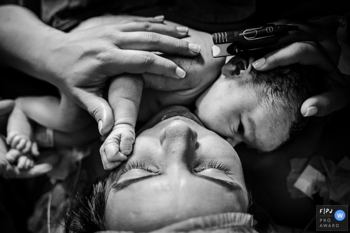 Moment-driven Hospital Plantadores de Cana birth photography of a newborn baby close to the mother's face