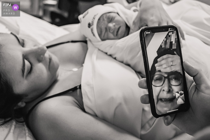 Moment driven Hospital Albert Einsten birth photojournalism image of a grandmother seeing her granddaughter for the first time