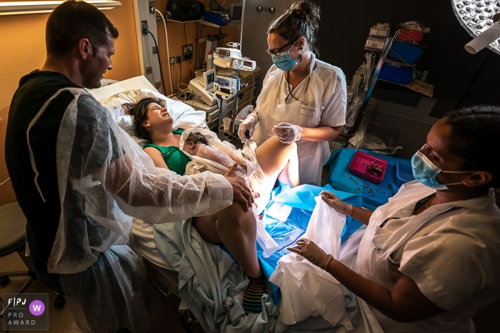 Moment-driven Centre Hospitalier Pierre Dezarnaulds birth photography showing baby just arrived,