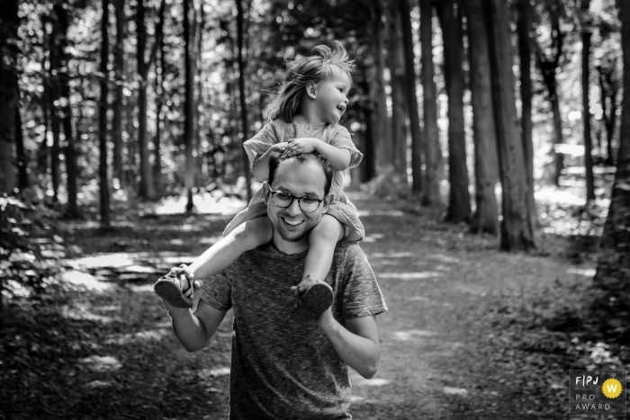 Moment-driven Limburg family photography covering a hiking trip with daddy carrying his daughter on his shoulders