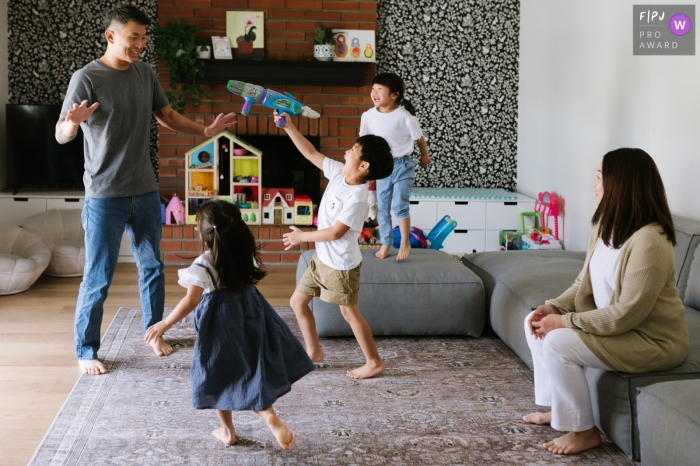 Moment-driven Los Angeles family photography showing an Asian family playing in the playroom