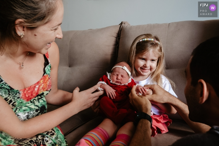 Moment-driven Santa Catarina family photography showing the Baby coming home and finding a big sister