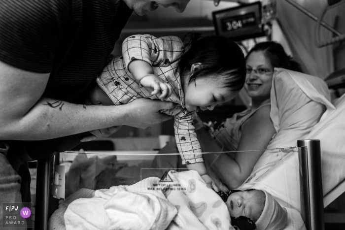 Martini Ziekenhuis birth photo with a proud sibling reaching out to her new family member