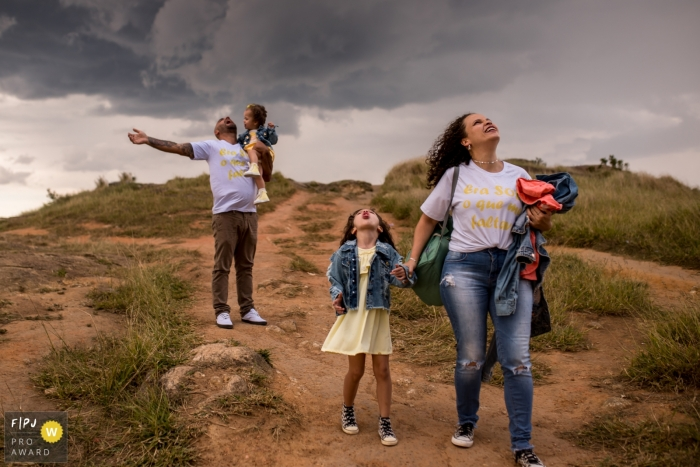 Sao Paulo family looking up into the sky at storm clouds before the rain arrived