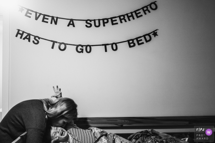 Antwerpen day in the life photography of a boy going to bed under the words 'Even a superhero has to go to bed'