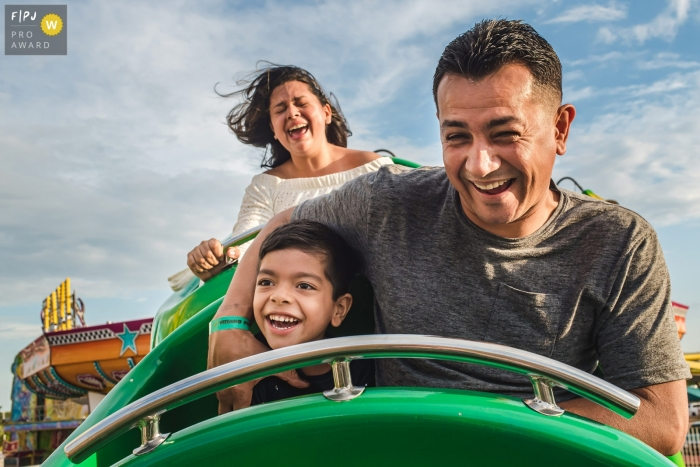 Campo Grande family outing photography of a family on a rollercoaster