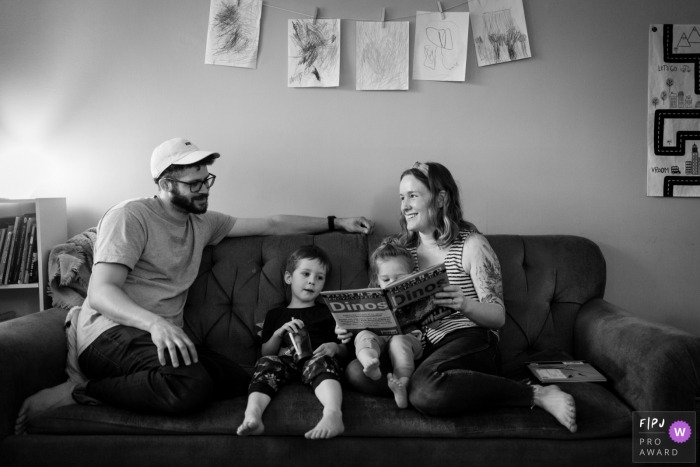 Atlanta Family reads a book on the couch together during this at-home photo session